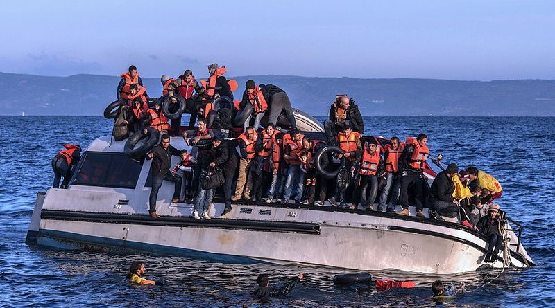 File photo of Proactiva Open Arms helping Syrian and Iraqi refugees in Lesbos, October 2015. Photo Credit: Ggia, Wikipedia Commons.