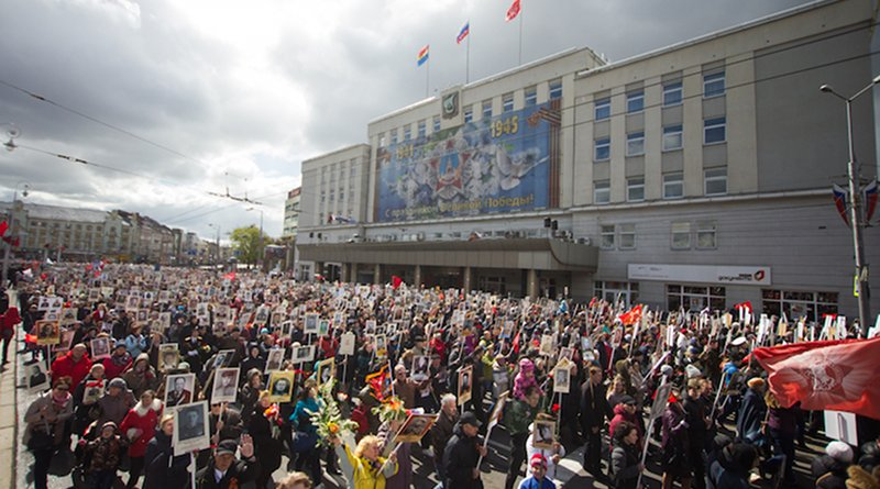 """Local residents in Kaliningrad at """"Immortal regiment"""", carrying portraits of their ancestors who fought in World War II, on Victory Day in Kaliningrad, 9 May 2017. CC BY-SA 4.0"""