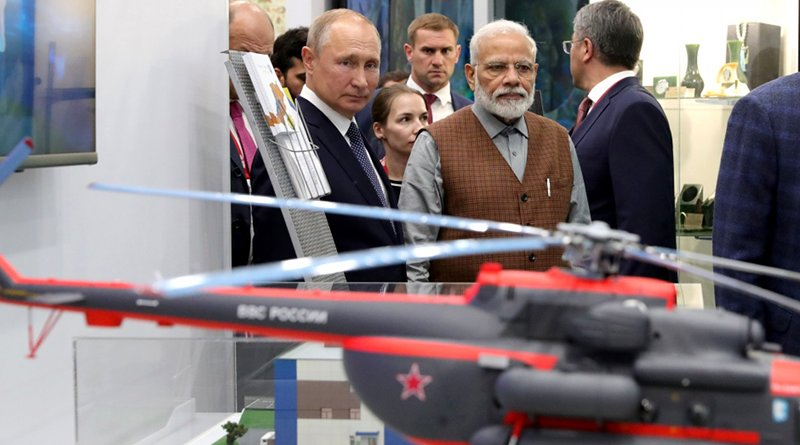 Russia's President Vladimir Putin with Prime Minister of India Narendra Modi during a tour of the Far East Street exhibition. Photo Credit: Kremlin.ru