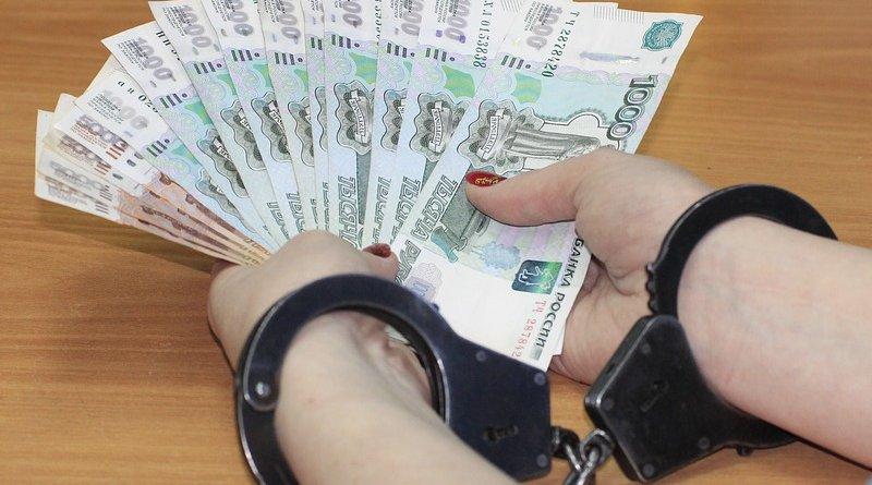 corruption bribe money currency handcuffs
