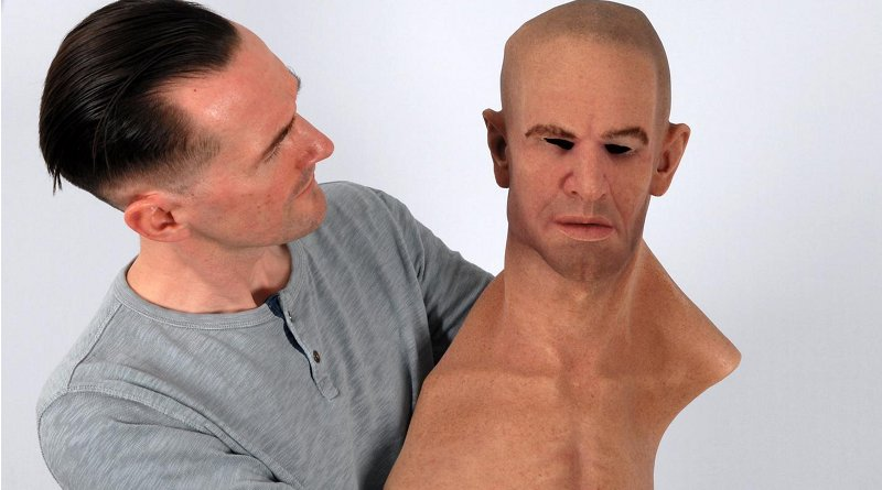 Dr. Rob Jenkins holds a hyper-realistic mask. CREDIT University of York