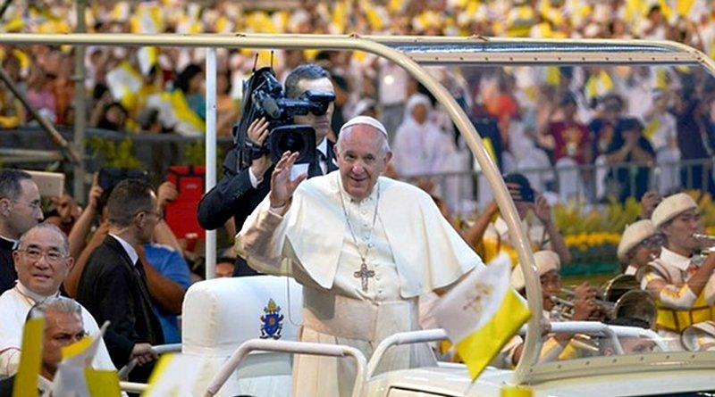Pope Francis waves as he arrives at the national sports stadium in Bangkok for an open-air Mass, Nov. 21, 2019. Photo Credit: Pimuk Rakkanam/BenarNews