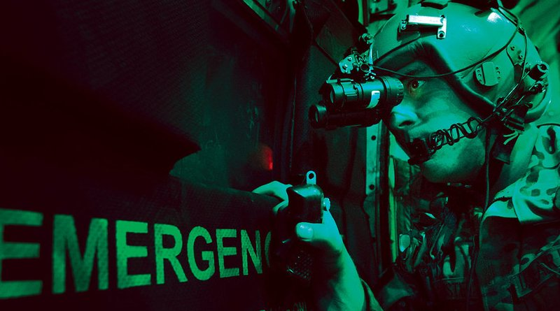 In 2013, A U.S. Air Force loadmaster scans for threats using night vision goggle aboard a C-130 aircraft after completing a cargo drop over Ghazni, province in Afghanistan. (U.S. Air Force/ Ben Bloker)