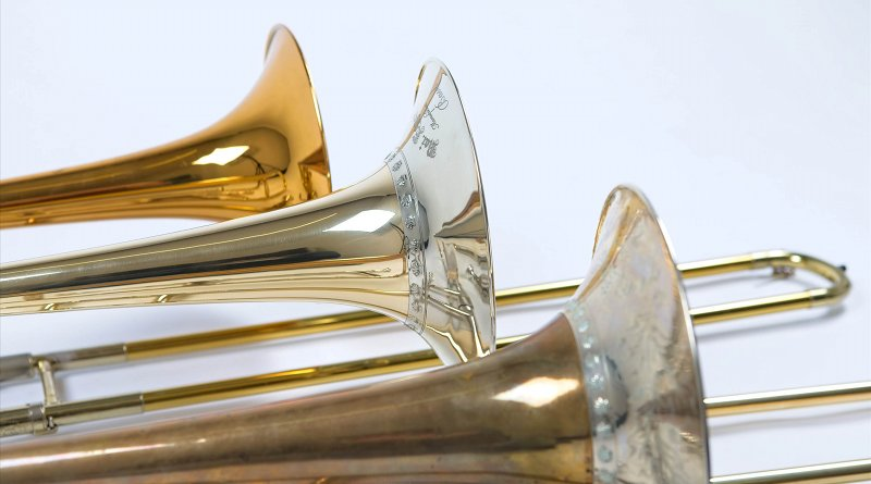 Precious Originals: Early Romantic Bass, Tenor and Alto Trombone. The historical original (front) of a romantic trombone and an exact replica (middle) manufactured by the brass instrument maker Egger in Basel and a modern-day instrument (back). Typically, the sound corona of the historic German trombone is covered with fine engravings. Image: Empa