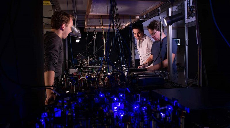 Adam Shaw, Ivaylo Madjarov and Manuel Endres work on their laser-based apparatus at Caltech. CREDIT Caltech
