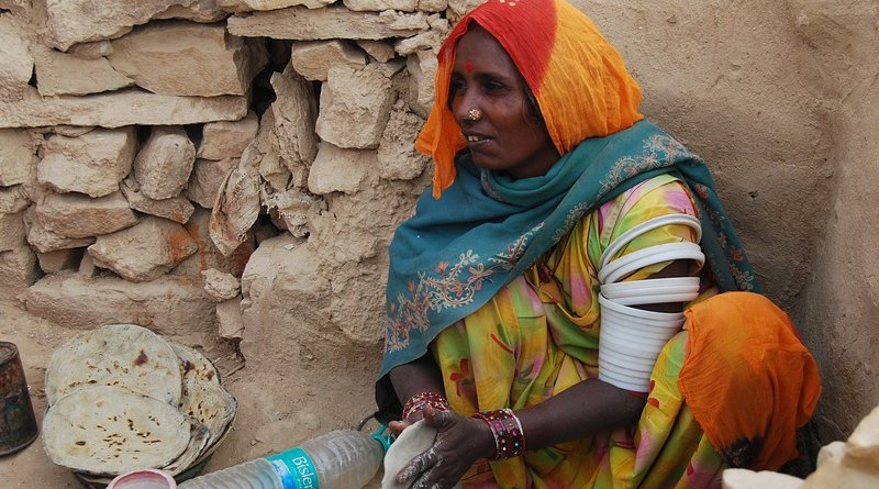 poor india woman cooking poverty