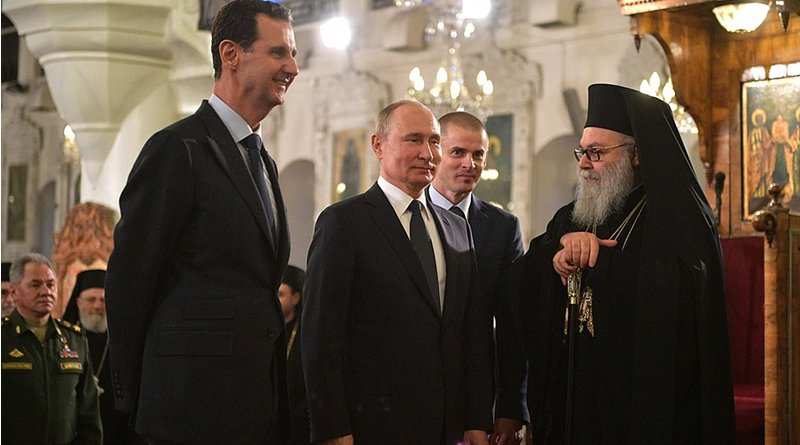 Russia's President Vladimir Putin at the Orthodox Mariamite Cathedral of Damascus, with Patriarch John X of Antioch and All the East. Left, Syrian President Bashar al-Assad. Photo Credit: Kremlin.ru
