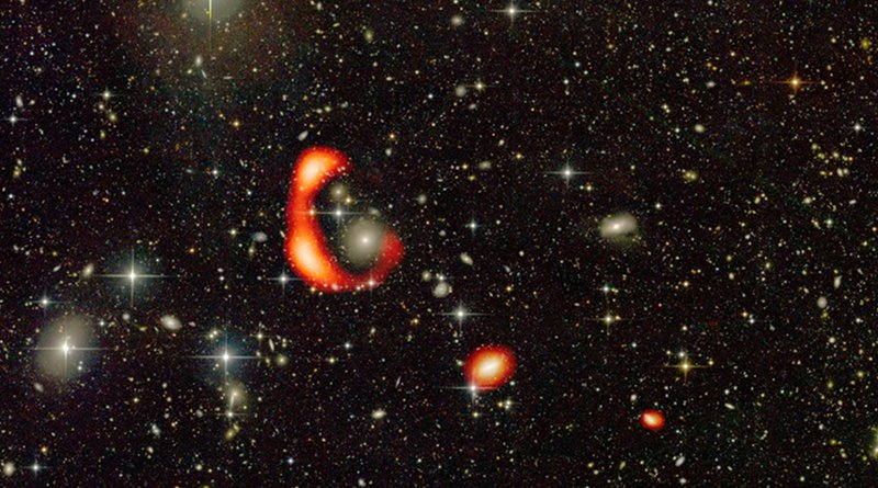The optical image from the CFHT telescope with the distribution of neutral hydrogen in the form of a large ring shown in red as observed by the GMRT. The other two red blobs show the distribution of neutral hydrogen around two other galaxies which are in the vicinity of the ring. CREDIT O. Bait (NCRA-TIFR/GMRT), Duc (ObAS/CFHT)