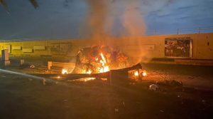 In this photo from social media, a burning car is shown after a rocket attack on the Baghdad International Airport on Jan. 3, 2020. IRAQ MINISTRY OF DEFENCE/FACEBOOK