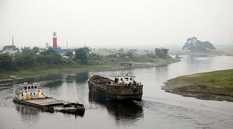 Boats pass each other along a Dhaka stretch of the Turag River, where the government plans to build a township along the waterway on the outskirts of the Bangladeshi capital, Dec. 27, 2019. Megh Monir/BenarNews