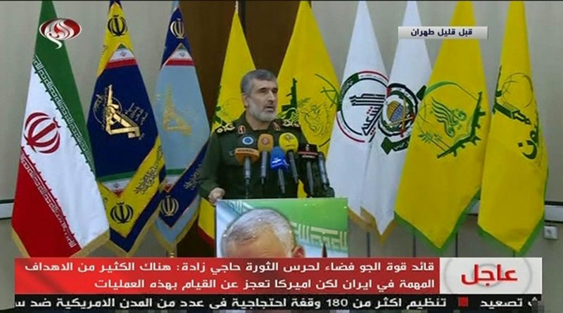 Gen. Amir Ali Hajizadeh in front of a range of Iranian proxy flags alongside official Iranian flags on state TV. (Screengrab)