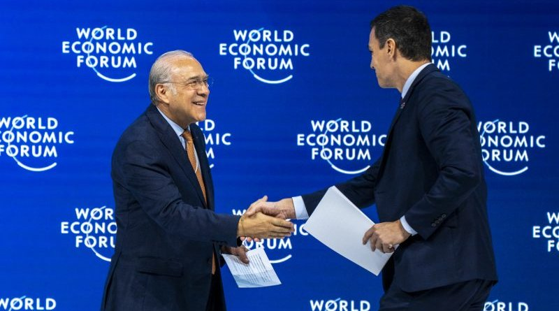 Pedro Sánchez, prime minister of Spain, and Angel Gurría, secretary-general of OECD, shake hands at the World Economic Forum in Davos. [World Economic Forum/Faruk Pinjo]