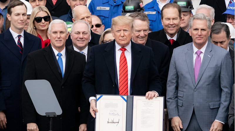 President Donald J. Trump, joined by Vice President Mike Pence and U.S. Trade Representative Robert Lighthizer, signs the United States-Mexico-Canada Trade Agreement Wednesday, Jan. 29, 2020, in front of the South Portico of the White House. (Official White House Photo by D. Myles Cullen)