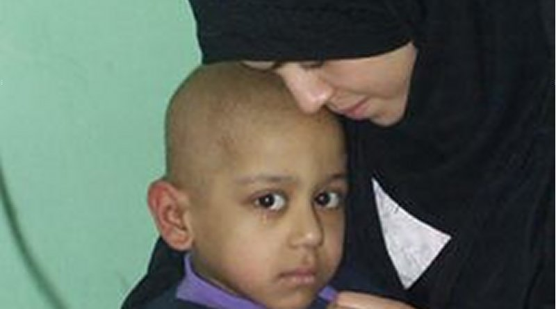 Cathy Breen, March 2003: Adra and her 5-year-old son Atarid in hospital. Atarid suffered from cancer. He died on the third day of the the United States' Shock and Awe bombing.
