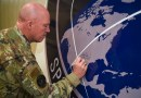 "Space Force Gen. John W. ""Jay"" Raymond, chief of space operations, signs the U.S. Space Command sign in the Perimeter Acquisition Radar building at Cavalier Air Force Station, N.D., Jan. 10, 2020. Photo Credit: Air Force Senior Airman Melody Howley"