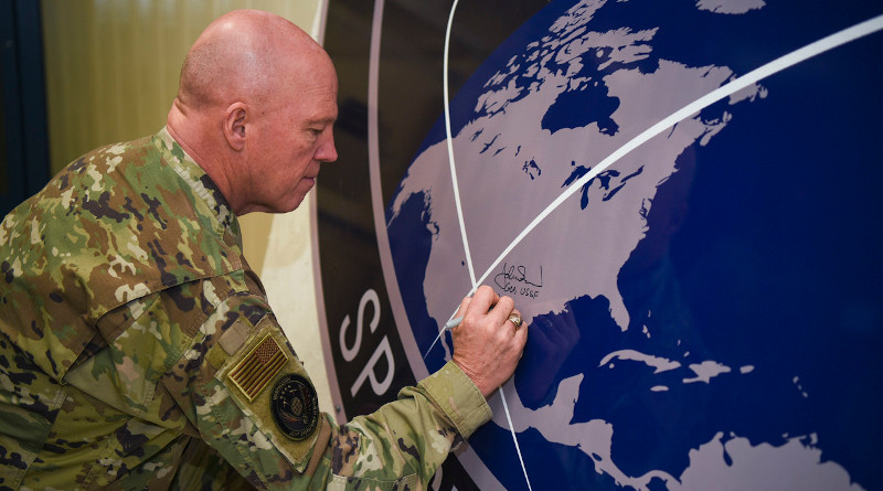 """Space Force Gen. John W. """"Jay"""" Raymond, chief of space operations, signs the U.S. Space Command sign in the Perimeter Acquisition Radar building at Cavalier Air Force Station, N.D., Jan. 10, 2020. Photo Credit: Air Force Senior Airman Melody Howley"""