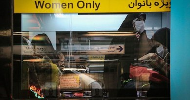 Women riding public transportation wearing masks in Iran. Photo Credit: Fars News Agency