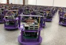 One hundred small robots line up in the laboratory. CREDIT Northwestern University