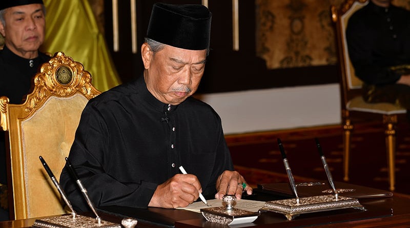 Malaysia's Muhyiddin Yassin signs document in swearing-in ceremony to become Prime Minister. Photo Credit: Malaysia Information Department