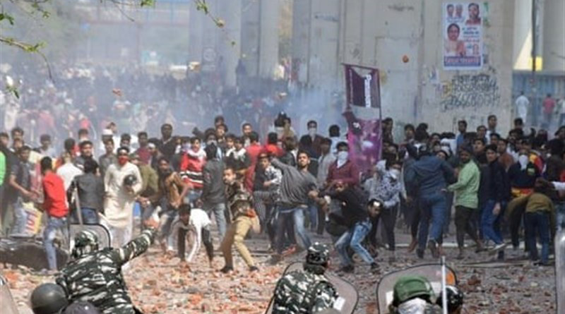 Protestors clash with security forces in Delhi, India. Photo Credit: Tasnim News Agency