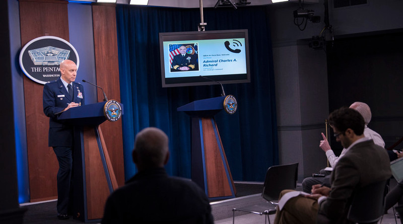Navy Adm. Charles A. Richard, commander of U.S. Strategic Command, briefs reporters at the Pentagon via telephone from Offutt Air Force Base, Neb., about Stratcom's response to COVID-19, March 17, 2020. The admiral is pictured on the monitor. Photo Credit: Lisa Ferdinando, DOD