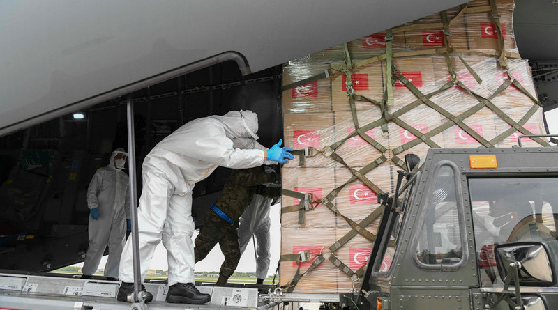 Turkish and U.S. Air Force crew members work together to unload medical supplies from a Turkish Airbus A400M Atlas at Joint Base Andrews, Md., April. 28, 2020. The Turkish aircraft landed at Andrews with medical supplies to respond to the coronavirus pandemic as a gesture of support from one NATO ally to another. Photo Credit: Air Force Airman 1st Class Spencer Slocum