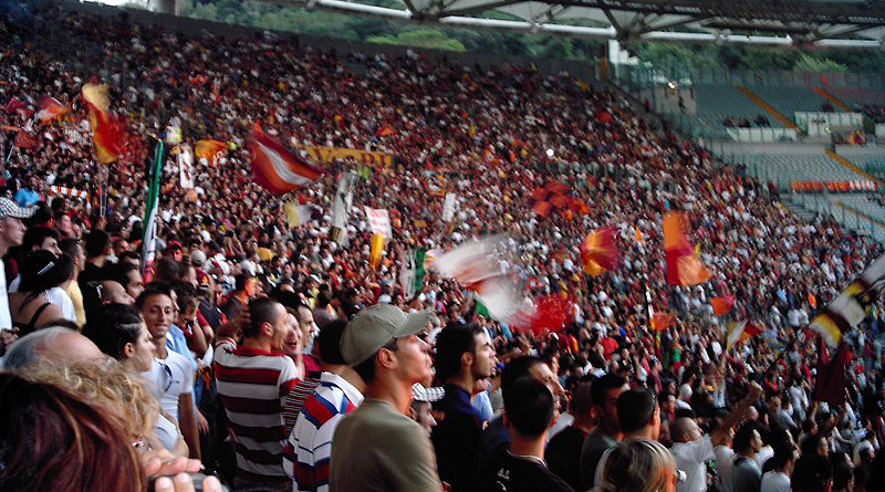 Roma football fans at the Stadio Olimpico. Photo Credit: kingpenguin1029, Wikipedia Commons
