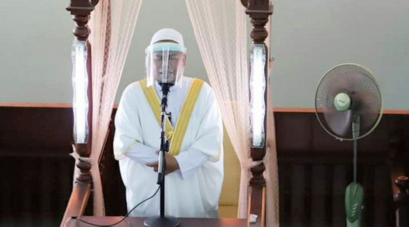An imam wears a face shield while preaching during Friday prayers at the central mosque in Narathiwat province in southern Thailand, May 22, 2020. Photo Credit: BenarNews