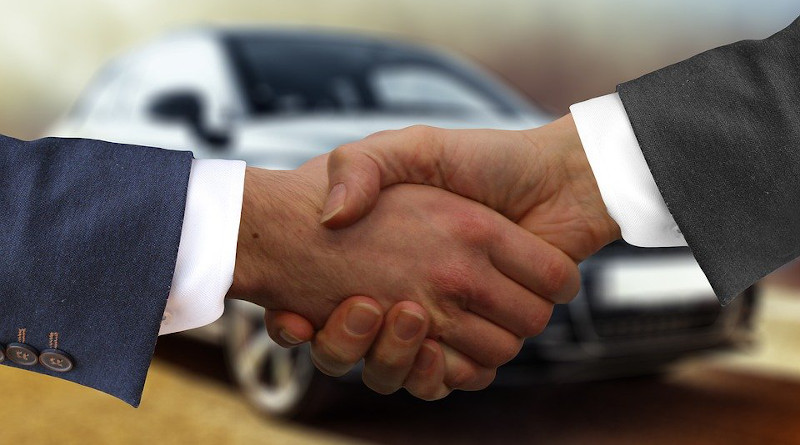 car auto sell dealer sale handshake