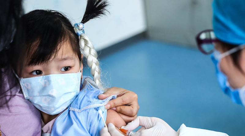 A three-year-old girl receives a vaccine shot at a community health centre in Beijing. Credit: UNICEF/Zhang Yuwei