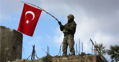 Soldier waves Turkish flag in Libya. Photo Credit: Fars News Agency