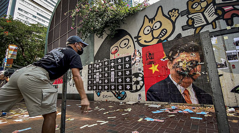 Hong Kong protesters threw eggs at the portrait of General Secretary of the Communist Party of China and paramount leader of China Xi Jinping. Photo Credit: Studio Incendo, Wikipedia Commons