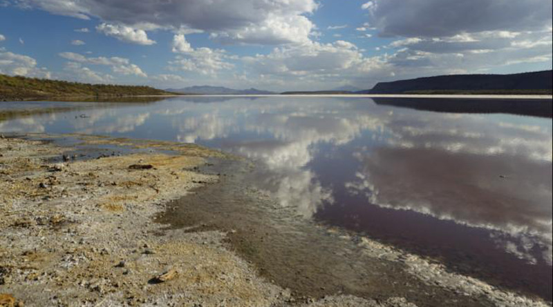 Clouds reflecting in lake Magadi, Kenya, located in the Eastern Branch of the East African Rift System. The high rising flanks of the Rift's border faults can be seen in the background. CREDIT: Corinna Kalich, University of Potsdam