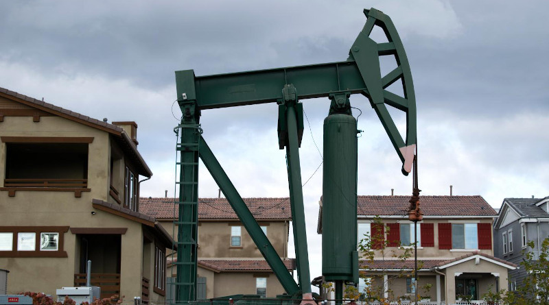 A pumpjack operating a well in the Signal Hill neighborhood in Los Angeles County, California. In the San Joaquin Valley, where pumpjacks are also in close proximity to houses, researchers found living near oil and gas development is a risk factor for spontaneous preterm birth. CREDIT: Photo credit: David Gonzalez