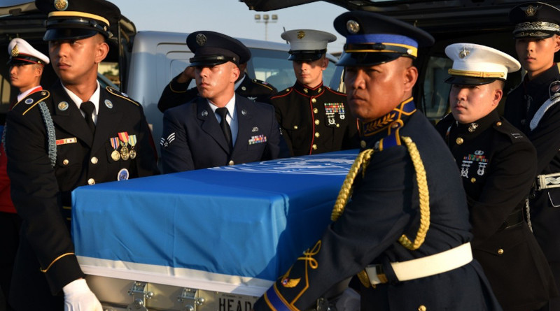 Members from the United Nations Command Honor Guard remove remains of a fallen service member from a vehicle and load it onto a waiting C-17 Globemaster III at Osan Air Base, South Korea, Aug. 1, 2018. The UNC repatriated 55 cases of remains fromNorth Korea. The Defense POW-MIA Accounting Agency will repatriate 147 of those remains to South Korea, June 23, 2020, following their identification as South Korean soldiers. Photo Credit: Air Force Senior Airman Kelsey Tucker