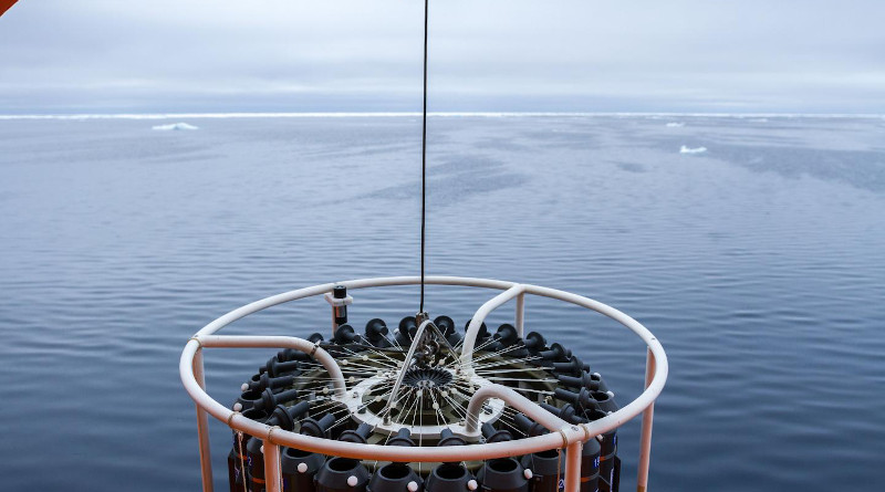 Scientific instruments hang over the ice-free Arctic Ocean during one of the expeditions that contributed data to a recent study published in Frontiers of Marine Science. Sea ice can be seen on the horizon. CREDIT: Photo from Nansen and Amundsen Basins Observational System.