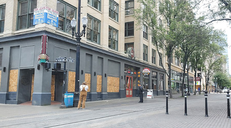 Boarded windows in downtown Portland following a series of demonstrations. Photo Credit: Another Believer, Wikipedia Commons
