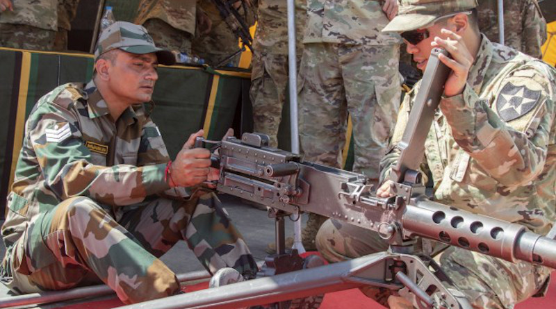 Spc. Kellin Kirby, a team leader with 1st Battalion, 23rd Infantry Regiment, instructs an Indian army soldier on the use of the M2 50 Cal. Machine Gun during a weapons demonstration Sept. 18, 2018, at Chaubattia Military Station, India. (Photo Credit: U.S. Army)