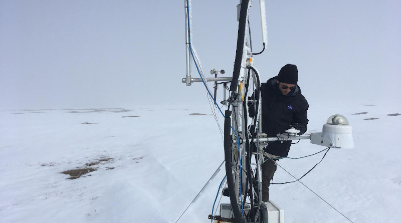 Ecosystem ecologist and post-doctoral fellow Kyle Arndt checking on the measurement equipment set up by SDSU in Utqiagvik (formerly Barrow), Alaska. New research finds that water from spring snowmelt infiltrates the soil and triggers fresh carbon dioxide production at higher rates than previously assumed. CREDIT: SDSU