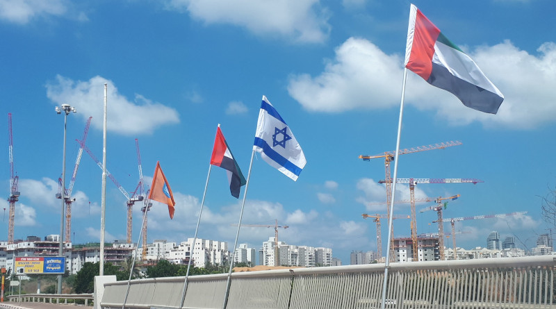 "Flags of Israel and the United Arab Emirates (UAE), together with the flag of Netanya, flown on Netanya's ""Peace Bridge"" over Highway 2, Netanya, Israel. Photo Credit: TaBaZzz, Wikipedia Commons"