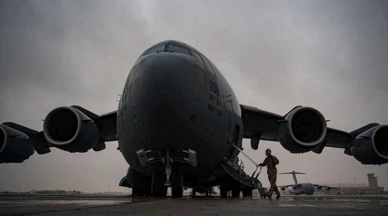 An Air Force C-17 Globemaster III pilot assigned to the 816th Expeditionary Airlift Squadron boards a C-17 at Al Udeid Air Base, Qatar, Jan. 10, 2020. C-17s such as this one are delivering relief supplies to Beirut following an explosion there Aug. 4, 2020. Photo Credit: Air Force Staff Sgt. Daniel Snider
