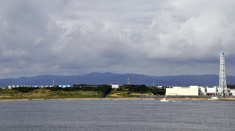 Some of the more than 1,000 tanks holding treated and untreated wastewater from the Fukushima Dai-ichi Nuclear Power Plant visible at left in this photo of the power plant site from 2013. CREDIT: Photo by Ken Buesseler, ©Woods Hole Oceanographic Institution