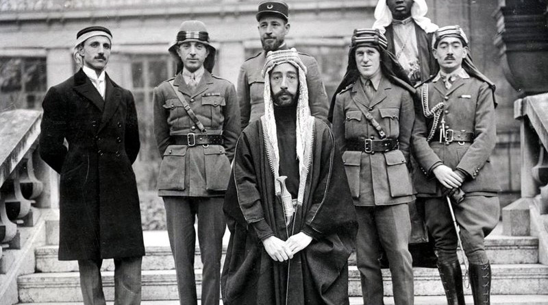 Emir Faisal's delegation at Versailles, during the Paris Peace Conference of 1919. Left to right: Rustum Haidar, Nuri as-Said, Prince Faisal, Captain Pisani (behind Faisal), T. E. Lawrence, unknown person, Captain Tahsin Kadry.