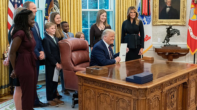 Judge Amy Coney Barrett and her family with US President Donald Trump and First Lady Melania Trump after being nominated for the Supreme Court. Photo Credit: Dan Scavino, the White House