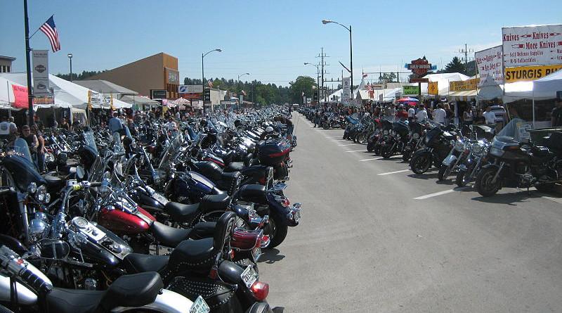Bikes lined up on Main Street during Bike Week, Sturgis, South Dakota. Photo Credit: Cumulus Clouds, Wikipedia Commons
