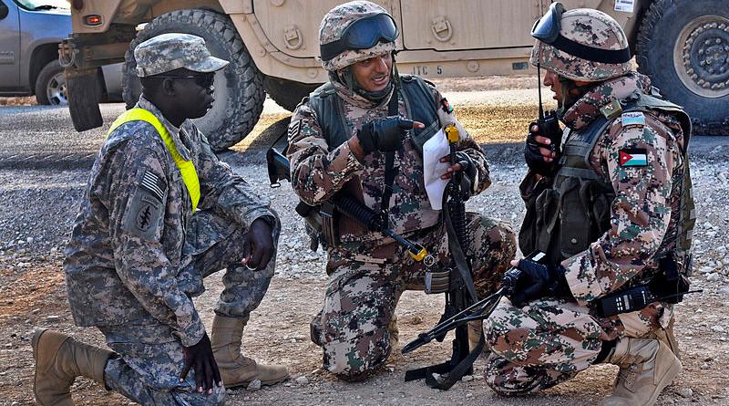 Jordanian soldiers discuss battle strategies with a U.S. Soldier. Photo Credit: Cpl Jordan Johnson/13th Public Affairs Detachment/U.S. Army, Wikipedia Commons