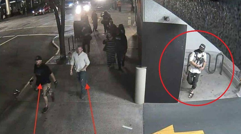 Surveillance footage released by police allegedly shows Michael Reinoehl (circled) as he prepares to follow two Patriot Prayer group members before shooting and killing one of the men. © Portland Police Department