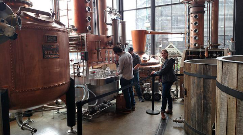 UT Department of Food Science graduate students collecting whiskey distillate samples for chemical analysis at the Sugarlands Distilling Company in Gatlinburg, Tennessee. Pictured are co-author Trenton Kerley, Melissa Dein, and Jordan Lopez. CREDIT: Photo by J. Munafo, courtesy UTIA.