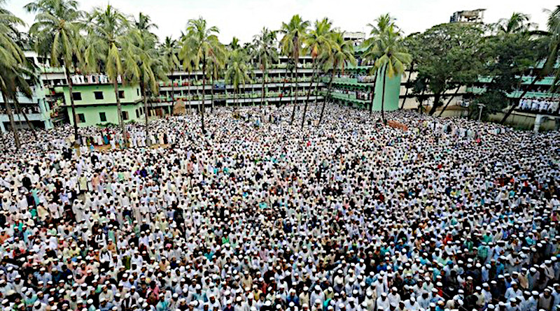 People attend the funeral ceremony of Hefazat-e-Islam leader Ahmed Shafi at the Hathazari madrassa in Chittagong, Bangladesh, Sept. 19, 2020. Photo Credit: Focus Bangla
