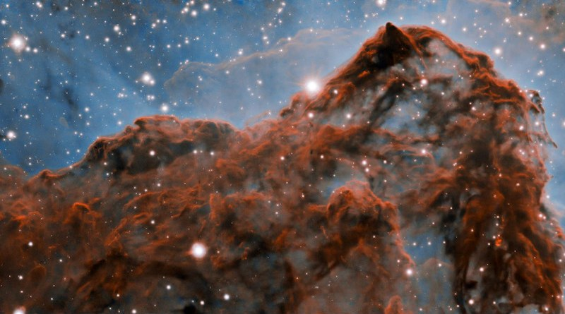 A 50-trillion-km (33-trillion-mile, or 5 light-year) long section of the western wall in the Carina Nebula, as observed with adaptive optics on the Gemini South telescope. This mountainous section of the nebula reveals a number of unusual structures including a long series of parallel ridges that could be produced by a magnetic field, a remarkable almost perfectly smooth wave, and fragments that appear to be in the process of being sheared off the cloud by a strong wind. There is also evidence for a jet of material ejected from a newly-formed star. The exquisite detail seen in the image is in part due to a technology known as adaptive optics, which resulted in a ten-fold improvement in the resolution of the research team's observations. CREDIT International Gemini Observatory/NOIRLab/NSF/AURA Acknowledgment: PI: Patrick Hartigan (Rice University) Image processing: Patrick Hartigan (Rice University), Travis Rector (University of Alaska Anchorage), Mahdi Zamani & Davide de Martin